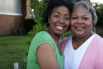 Happy African American mother and her daugher.