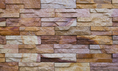 Colorful sandstone bricks wall background