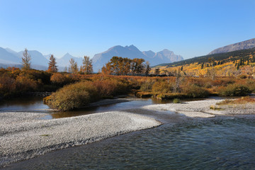 Wall Mural - St. Mary River in Glacier National Park with Fall Colors
