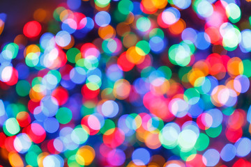 Blurred lights colorful background. Glittering christmas effect. Abstract colorful pattern. Shimmering blur spots. Festive design.