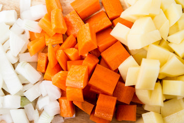 Diced carrots & diced potatoes on a cutting board