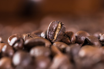 Brown aromatic coffee beans background, selective focus
