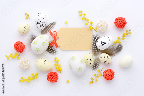 Easter eggs and mimosa flowers on white background with blank card easter eggs and mimosa flowers on white background with blank card to greet top view m4hsunfo