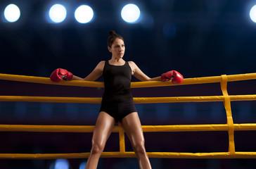 Woman training gym boxing mma ring