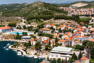 Fotobehang Nice Birds view of the bay of adriatic resort Shibenic. Yachts in harbor and red roofs of houses, of old mediterranean town.