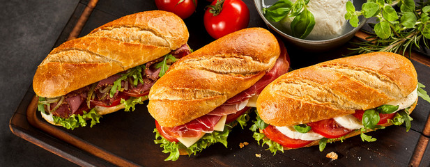 Foto op Canvas Snack Trio of three fresh sandwiches