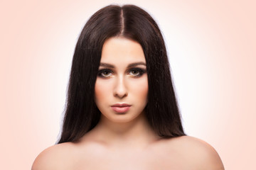 Beauty woman face portrait with clean fresh skin, long hair and bright evening make up.