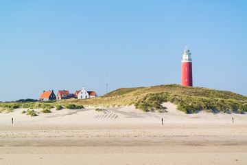 Beach and lighthouse De Cocksdorp, Texel, Netherlands