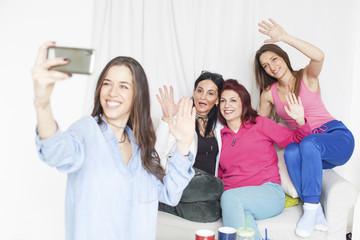 4 beautiful women having fun and taking selfie
