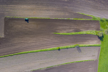 Tractor on field, aerial view