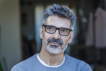 Portrait of mature man wearing glasses