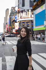 Fashionable young asian woman commuting in Time Square, Manhattan (travel, journey, commute,tourism, walk,city life)