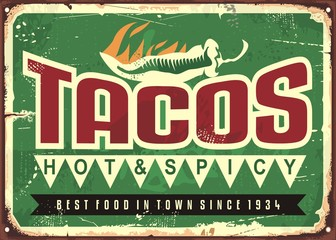Hot and spicy tacos advertise on old green metal background