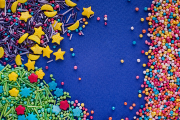 Colorful sprinkles on a blue background