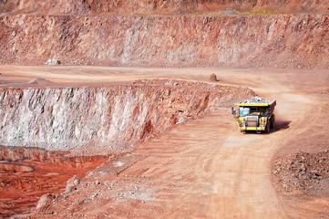 quarry mine of porphyry rock. dumper truck driving around