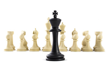 Chess business concept, leader & success. Black king in front of set of white figures