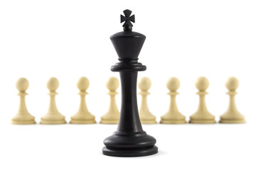Chess business concept, leader & success. Black king in front of white pawns