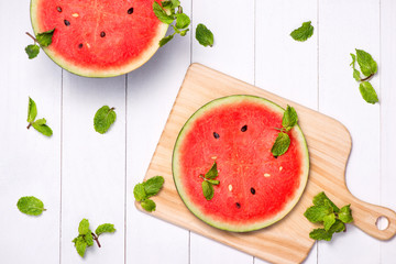 Watermelon juice, watermelon slices and mint leaves. Dessert. Flat lay, top view