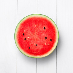 A half of fresh watermelon isolated on white background. Dessert. Flat lay, top view