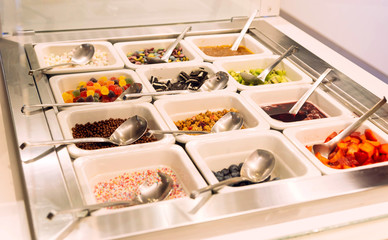 sweets for powdering  ice cream strawberry, nuts, chocolate biscuits, topping, kiwi fruit, jelly candy, blueberry,