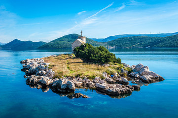 Tuinposter Eiland small island with a very old lighthouse located in southern Croatia, Dalmatia