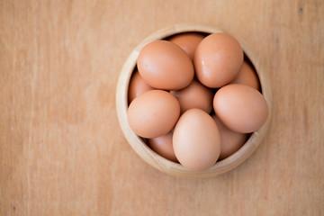 Egg chicken egg in wood bowl