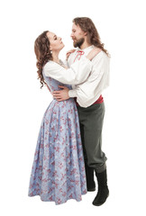 Beautiful couple woman and man in medieval clothes isolated