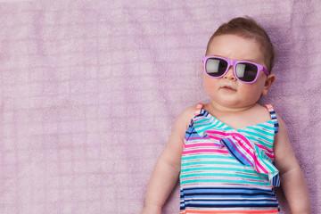 Newborn baby in beachwear