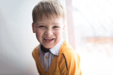 portrait if happy boy. natural light from window
