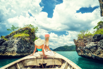 Young woman traveler on longtail boat trip at island hopping