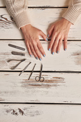 Wall Mural - Well-groomed hands in a manicure salon.