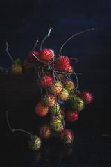 Red Rambutans on the dark background