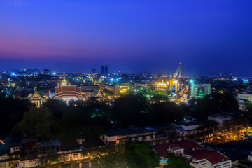 Cityscape view of bangkok under pink and blue sky.