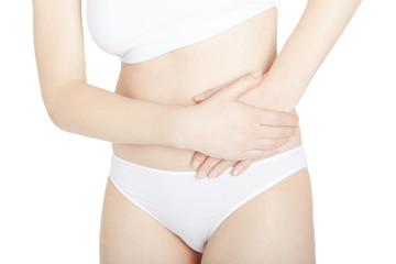 Woman with lateral abdominal pain isolated on white, clipping path