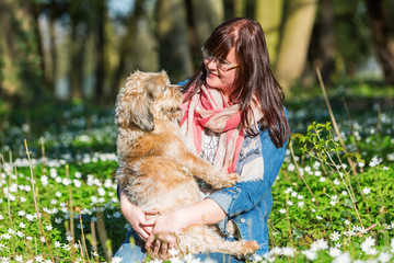 young woman and her dog between thimbleweeds