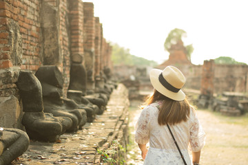 Woman traveler is sightseeing Ayutthaya ancient City tour.