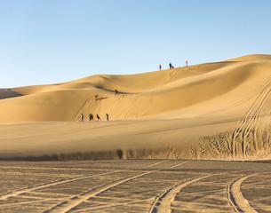 Tourists travel through the dunes in the Atacama Desert - Oasis of Huacachina, Peru, South America