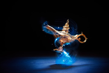 Magic Aladdin / Genie lamp floating on a dark background