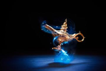 Magic Aladdin / Genie lamp floating on a dark background Fotoväggar