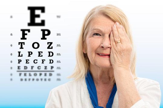 Senior woman testing vision with eye chart