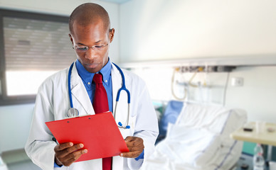 African doctor reading a clipboard