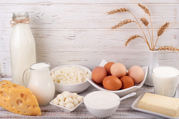 Foto op Aluminium Zuivelproducten Dairy products on wooden table. Milk, sour cream, cheese, egg, yogurt and butter. Healthy food, diet concept. Copy space