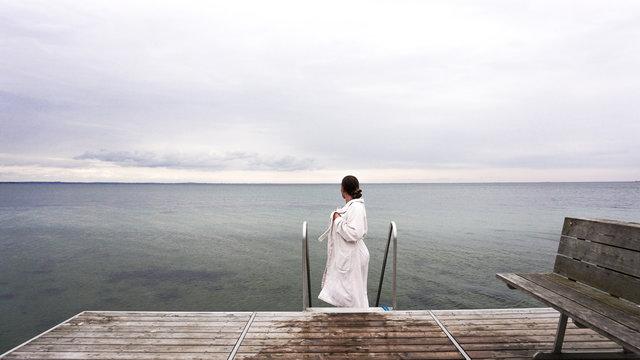 Woman swimming in winter
