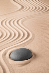 Foto op Aluminium Zen Zen background with stone and pattern of lines in the sand. Focus on concentration and spirituality for harmony and purity. Spa wellness therapy or yoga theme...