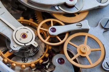 Cogs gears connection teeth. Vintage stopwatch chronometer mechanism macro view, selective focus photo