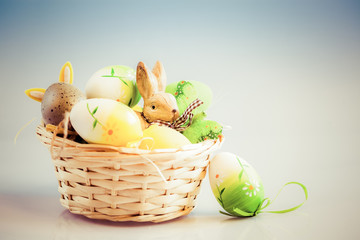 easter eggs and bunny in basket