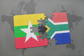 puzzle with the national flag of myanmar and south africa on a world map