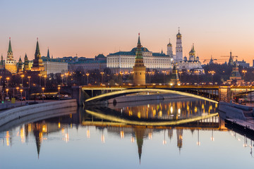 Illuminated Moscow Kremlin and Moscow river in summer morning. Pinkish and golden clear sky. Russia