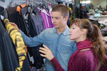 Couple in store looking at clothing