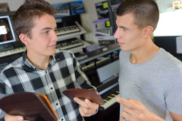 Young men in musical instrument shop